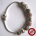 Bracelet souple avec perles roses et argentées (Attention produit non artisanal)